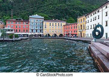 Riva Del Garda, Italy - May 12 2014: Riva Del Garda boardwalk on Lake Garda in Italy. Riva Del Garda is one of the most popular cities visited by tourists every summer.