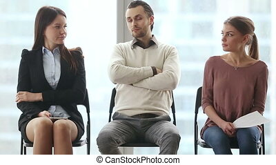 Rivals waiting for job interview - Group of three young...