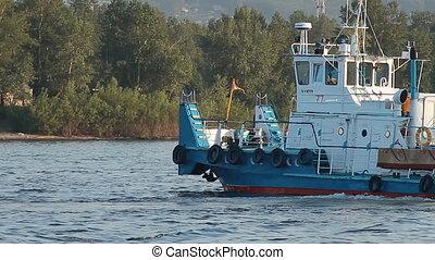 River 008 - Moving tugboat.