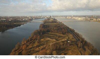 River aerial video of Daugava and TV tower in Riga, Latvia, Europe - panoramic view