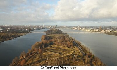 River aerial video of Daugava and TV tower in Riga, Latvia, Europe - panoramic view