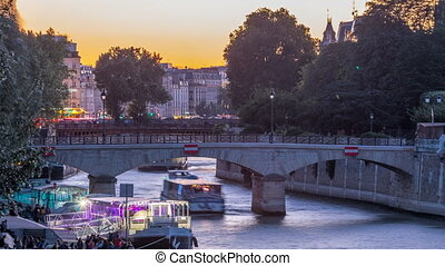 River and bridge near Notre Dame De Paris cathedral day to...