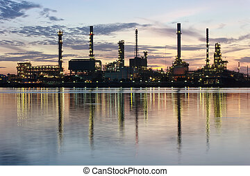River and oil refinery factory with refection in Bangkok, Thailand.