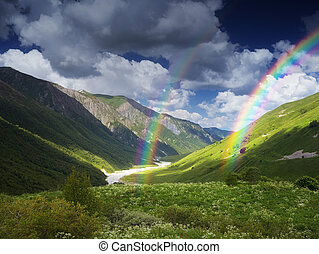 River and rainbow in the mountains