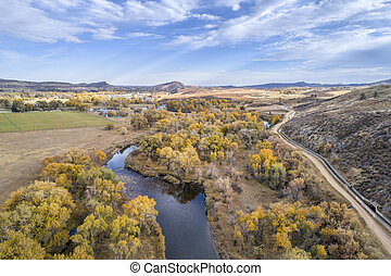 Cache la Poudre River and water diversion ditch (Charles Hansen Canal) at foothills above Fort Collins, Colorado - aerial view with fall scenery
