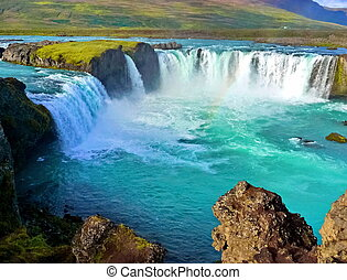 Blue wide river with waterfall in iceland landscape