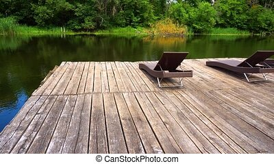 River and wooden pier with loungers. Amazing place for...