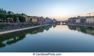 River Arno and famous bridge Ponte Vecchio day to night...