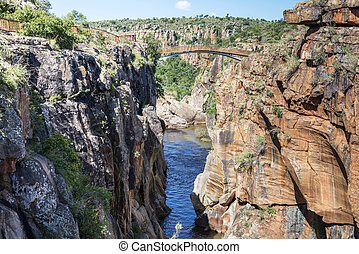 river at the bourkes potholes in south africa near the panoramaroute with big canyon and waterfalls
