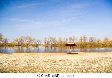 River beach in the autumn.