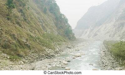 River between nepalese mountains. Manaslu circuit trek. - ...
