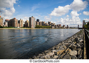 River between the city with cloudy blue sky, New York