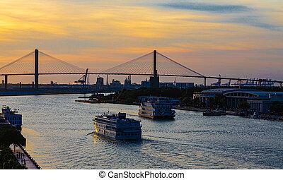 River Boat and Cruise Ship at Bridge