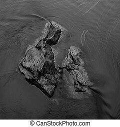 River Boulders Peek Above Rushing Water