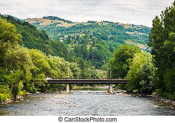 river bridge - landscape with mountains trees and a bridge...