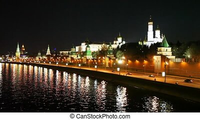 River, cars on road, Kremlin walls and towers in Moscow city