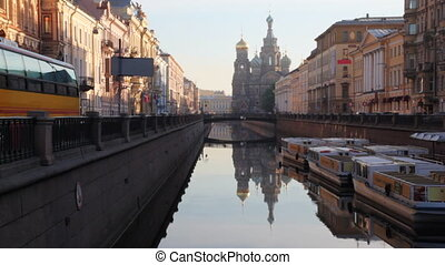 River channel with boats and Church of Savior on Spilled Blood far away