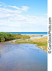river, coastline and blue sea