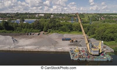Aerial view large crane an excavator mounted on barge. Excavator on river for unloading and loading sand and rubble.