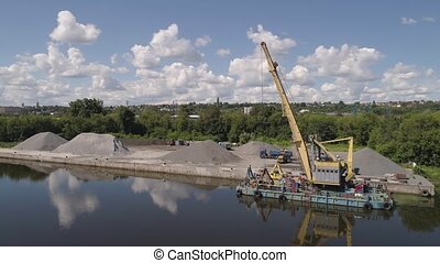 River crane excavator on barge. - Aerial view large crane an...