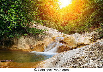 River deep in mountain forest.