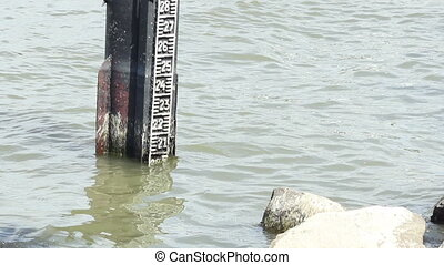 A metal pillar, stick onto the bottom of the river, to measure the depth and fluctuation in flow of a large river.