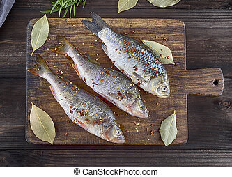 river fish crucian and perch in spices and salt
