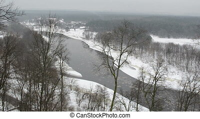 river floe park winter - neris river with floe flowing...