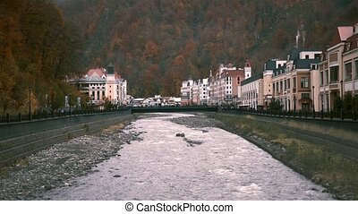 River flowing in Sochi, houses and people