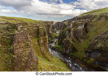 River flowing through Fjarrgljfur canyon in Iceland, Europe.