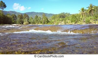 river flows stream fast against pictorial landscape -...
