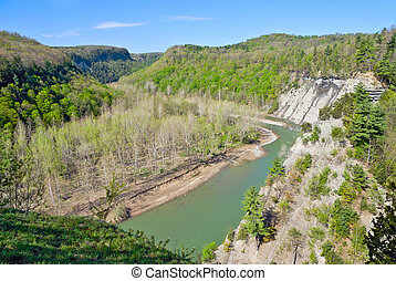 Landscape of river running through gorge caused by glacier