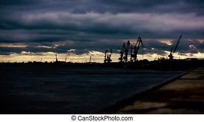 River harbor cranes at sunset. Time-laps