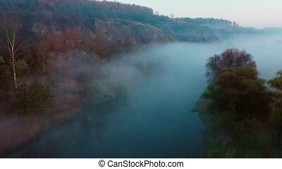 River hidden in mist - Aerial view of river hidden in ...