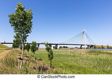 River IJssel with bridge near Kampen in The Netherlands -...