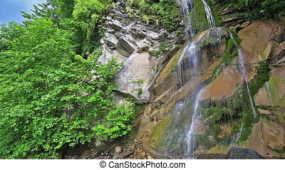 River in Caucasus mountains forest, waterfall near lake Ritsa, Abkhazia, Georgia