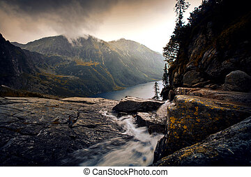 River in foggy mountains landscape.