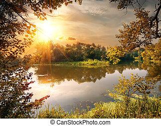 River in october - Beautiful calm river at sunrise in...