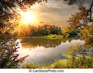 River in october - Beautiful calm river at sunrise in...