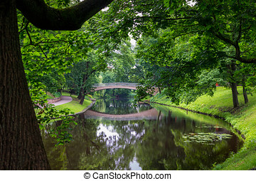 River in Riga - Summer River landscape with bridge and...