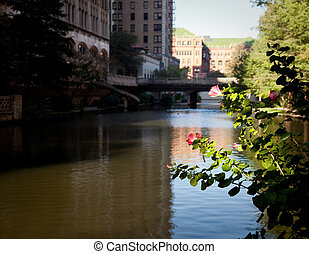 River in San Antonio with old buildings