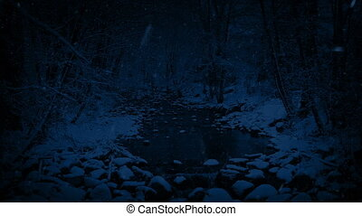 River In Snowy Woodland At Night - Snow falling on river in...