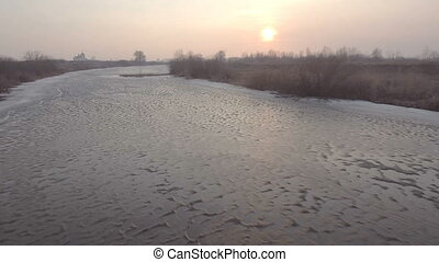 River in winter. Aerial View. Flight over the beautiful winter river