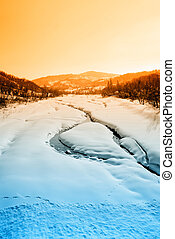 river in winter at sunset