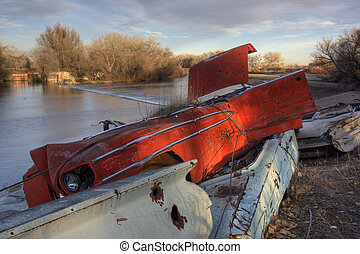 river irrigation dam and junk cars on a shore
