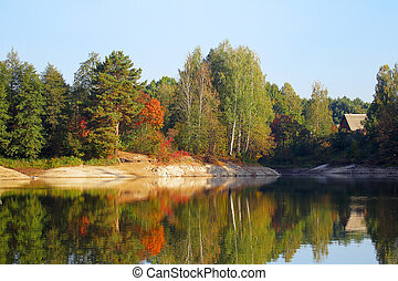 River landscape in autumn forest at sunrise