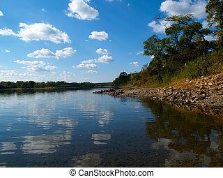 river landscape with blue sky and white clouds reflection