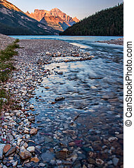 River Leading to Waterton Lake With Orange Mountain - The...