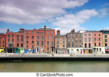 River Liffey and colorful buildings at summer day in Dublin,...