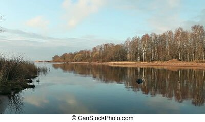 river mirror reflection - beautiful river landscape at...